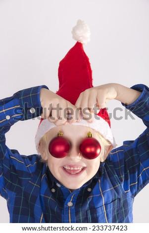 child with Christmas balls - stock photo