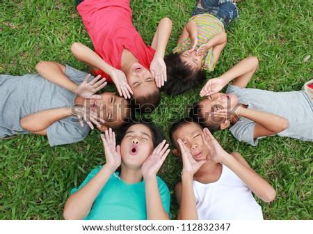 6 children having good time in the park. - stock photo