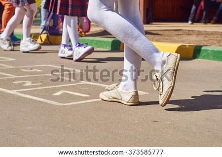 Children playing hopscotch at school yard after the lessons                            - stock photo