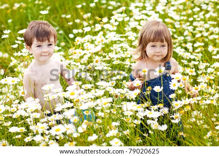 2 children playing outdoors - stock photo