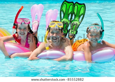 Children scuba diving - stock photo