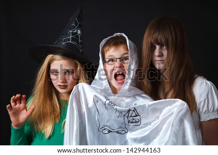 3 children with halloween costumes - stock photo