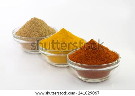 Chili Powder, Turmeric Powder & Coriander powder in Bowl isolated on White.  - stock photo