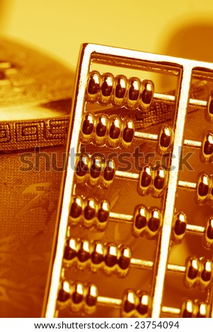 chinese gold ingots and abacus - stock photo