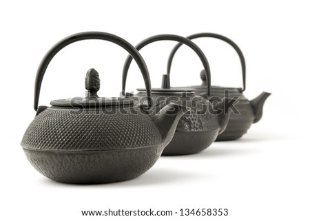 3 Chinese iron black traditional teapots - stock photo