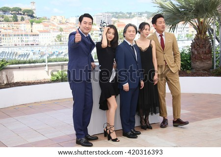 Cho Jin-Woong,  Park Chan-Wook attends 'The Handmaiden (Mademoiselle)' photocall during the 69th annual Cannes Film Festival at the Palais des Festivals on May 14, 2016 in Cannes, France. - stock photo
