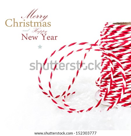 Christmas composition with ribbon decorations and snow isolated on white background  (with easy removable sample text) - stock photo