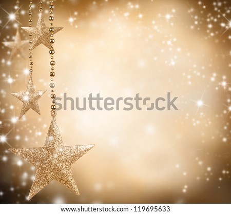 Christmas theme with golden stars and free space for text - stock photo