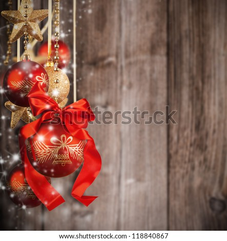 Christmas theme with red glass balls on blur wooden texture - stock photo