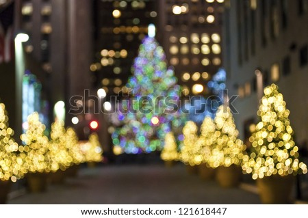 """Christmas Trees Blur"" An abstract blur of Christmas trees in Rockefeller Center in New York City. - stock photo"