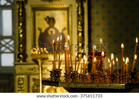 church. Orthodoxy. Orthodox Church. Christianity. candles. church candles. lighted candle. icons. icon. religion. - stock photo