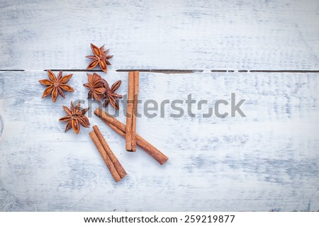 cinnamon stick and star anise spice on wooden background - stock photo