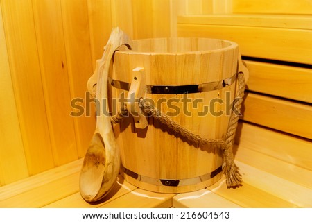 Classic wooden sauna inside. Detail of bucket  in a sauna. - stock photo
