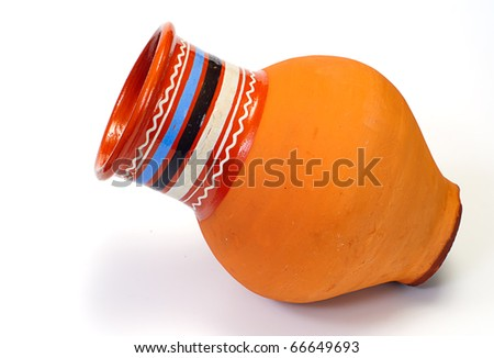 clay pot of manual work on the white background - stock photo