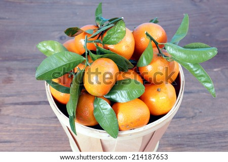 clementine mandarin fruit in bucket display at market place  - stock photo