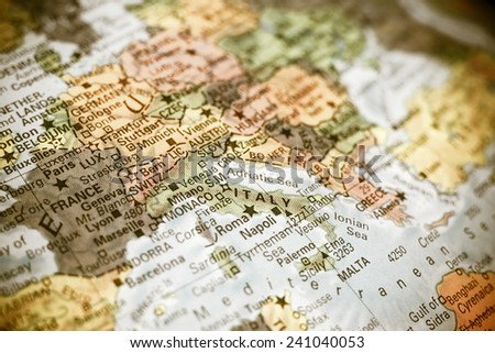 close-up macro photograph of map  Italy . Selective focus on Italy - stock photo