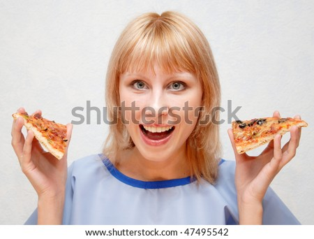 Close-up of a girl with a pizza. - stock photo