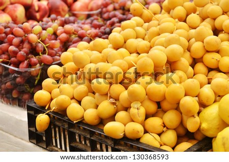 Close up of fresh dates and  grapes on market stand in Jerusalem, Israel - stock photo
