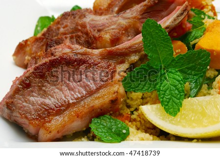 close up of lamb chops with mint - stock photo