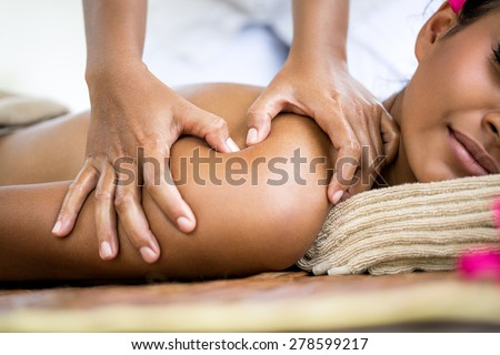 Close up of massager hands massage shoulder - stock photo