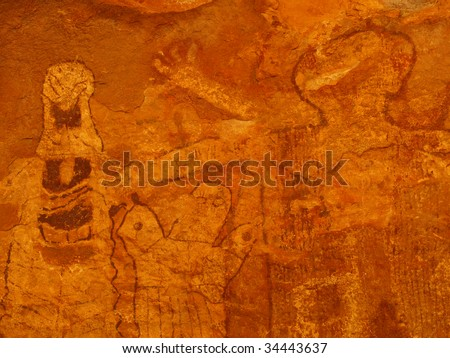 Close up of pictographs painted on cave wall by prehistoric Native American(s), possibly thousands of years old. Remote cave inside Grand Canyon National Park, Arizona, USA. - stock photo