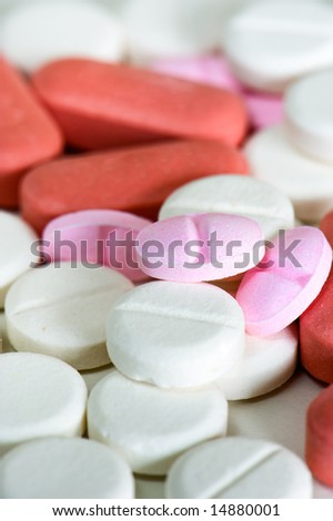 close up of pink, red and white pills - stock photo