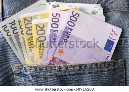 Close-up of the fan Euro banknotes in jeans pocket. - stock photo