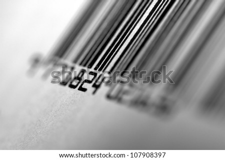 Close up shot of Barcode. Black and white. Focus on central numbers. Soft focus. - stock photo