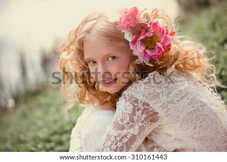 Closeup lifestyle portrait little bridesmaid  with bouquets  Beautiful Teenage Girl Having Fun in Autumn Park  with bunch of flowers wedding concept  cute princess girl Happy little schoolgirl   - stock photo