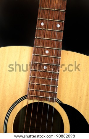 closeup of acoustic guitar - stock photo