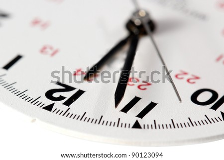Closeup view of watch face on white - stock photo