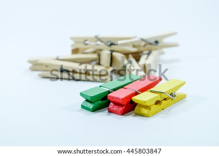 Clothespin three color and texture on white background. - stock photo