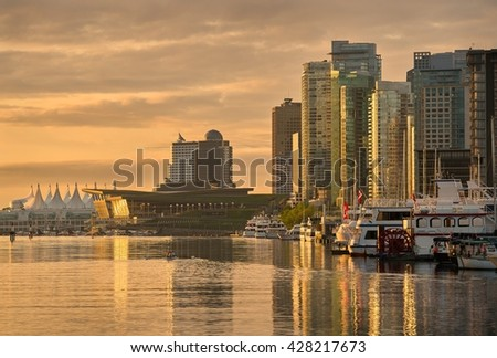 Coal Harbor Morning, Vancouver. Vancouver's city center and Coal Harbor at sunrise. Rowing team practice. British Columbia, Canada.                        - stock photo