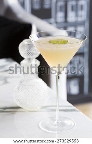 Cocktail decorated with lime serve on marble table - stock photo