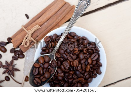coffe sugar and spice on silver spoon over white wood rustic table  - stock photo
