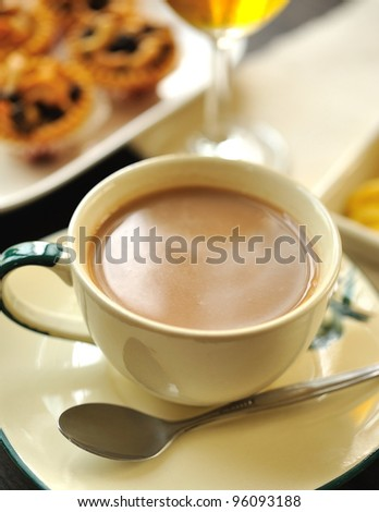 coffee with milk in cup with almond pies - stock photo