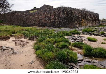 Colonia del Sacramento, Uruguay. The historic quarter is an UNESCO World Heritage Site. Fortress ruins panorama - stock photo