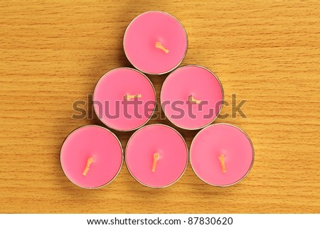 color candle are locate on wood ground - stock photo