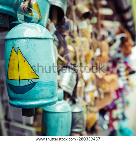 Colorful ceramic bells at the autumn market. - stock photo