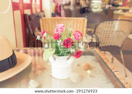 Colorful decoration artificial flower in a vase (vintage)  - stock photo