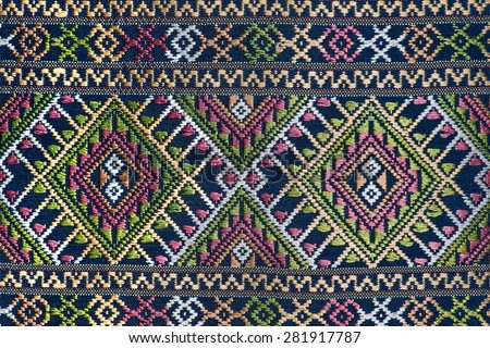 .Colorful thai silk handcraft peruvian style rug surface close up More this motif & more textiles peruvian stripe beautiful background tapestry persian nomad detail pattern farabic fashionable textile - stock photo