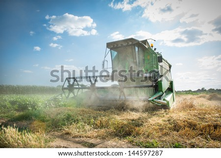 combine working on the Wheat field - stock photo