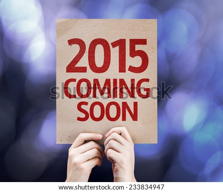 2015 Coming Soon written on colorful background with defocused lights - stock photo