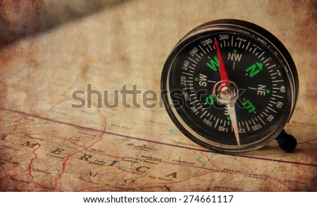compass  in the map.Vintage textured picture - stock photo