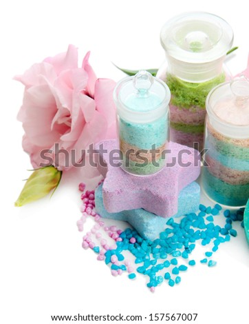 Composition with aromatic salts in glass bottles and flower, isolated on white - stock photo