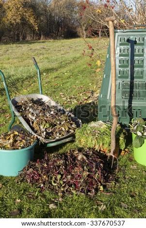 Compost bin, waste, mulch in a autumn garden. - stock photo