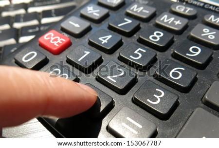 computing using calculator  - stock photo