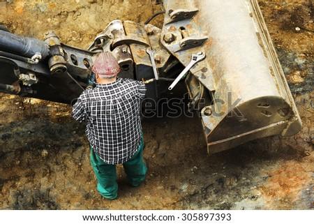 construction bulldozer excavator machine industry  maintenance on city street - stock photo
