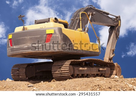 construction site digger, excavator and dumper truck. industrial machinery on building site - stock photo