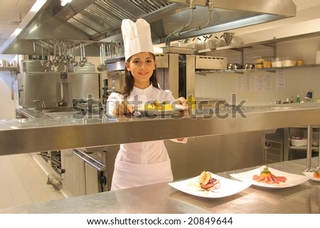 cook in a kitchen of a restaurant - stock photo
